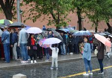 People stand in the rain in the queue to the mausoleum of Vladimir Lenin. Stock Photography