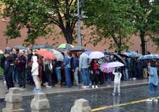 People stand in the rain in the queue to the mausoleum of Vladimir Lenin. Royalty Free Stock Photo