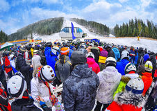 People stand before ski lift in queue in Bukovel Stock Image