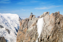 People stand on top of big ridge in the Alps Stock Photo