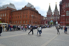 People stand in turn on Red Square through Voskresensky gate in. Moscow, Russia Stock Photo