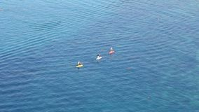 People on stand up paddle board in the sea. Greece stock video