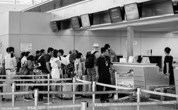 People standing at the counters in Danang airport, Vietnam Stock Images