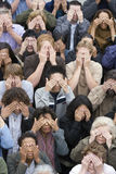 People Standing With Covering There Eyes Stock Photo