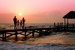 People Standing on Dock during Sunrise Stock Image