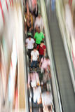 People standing on an escalator Stock Photo