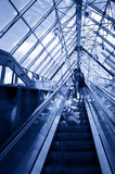 People standing on escalator in business center Royalty Free Stock Image