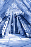 People standing on escalator in business center Royalty Free Stock Images