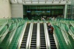 People standing on the escalators stock photography