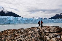 People standing in front of the Perito Moreno glacier stock photography