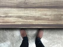 People standing in front of a wooden table. Top view. Can edit and compose your work Stock Photos