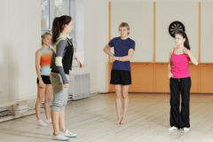 People standing in gym Royalty Free Stock Photo
