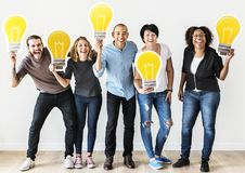 People standing and holding lightbulb icon Stock Image
