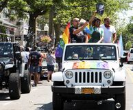 People standing in jeep during Gay Pride car parade