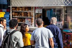 People standing in line at food cart in New York Stock Images
