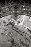 People standing in line under the Eiffel Tower in Paris Stock Photo