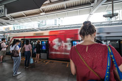 People standing in lines, playing smartphone while waiting for BTS sky train Royalty Free Stock Images