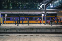 People Standing Near Train Under Shed Stock Photos