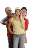 People standing one after anot. Smiling 2 men and a woman in sport clothes and in caps standing one after another Royalty Free Stock Photography