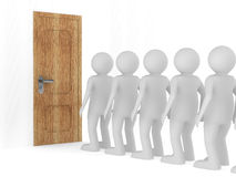 People standing one after another before closed door Stock Image