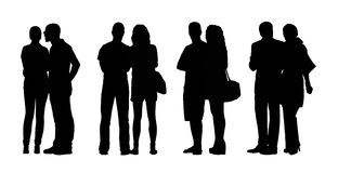 People standing outdoor silhouettes set 29. Silhouettes of ordinary adult couples standing outdoor in different postures, talking, looking Stock Images