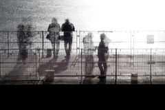 People standing on a pier. Multiple exposure of people standing on a pier Royalty Free Stock Image