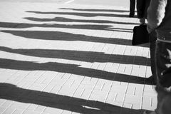 People standing in a queue. Shadow of a people standing in a queue Royalty Free Stock Photography