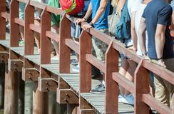 People. People standing in a queue on the bridge royalty free stock image