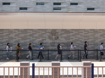 People standing in a queue in front of The Consulate General of United States 3 Royalty Free Stock Photos