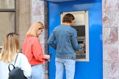 People standing in queue to cash machine royalty free stock photo