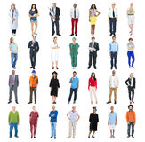 People Standing in a Row Isolated on White. Group of People Standing in a Row Isolated on White royalty free stock photos