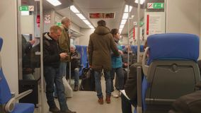 MOSCOW - CIRCA NOVEMBER 2017: People standing and sitting in carriage of train of Moscow central circle. People standing and sitting in carriage of train of stock video