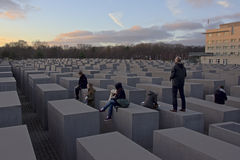 People standing and sitting on the Memorial to the Murdered Jews of Europe, Berlin Royalty Free Stock Photo