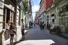 People talking in street with ruinous houses, Havana, Cuba Stock Photos