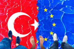People standing on Turkey and Eu cracked flag Royalty Free Stock Image