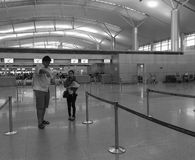 People standing and waiting at the Tan Son Nhat airport in Saigon, Vietnam Stock Image