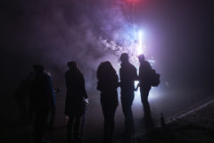 People standing and watching fireworks, silvester, dark, silhouette. People standing and watching fireworks, silvester, dark Stock Photography