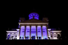 People stant in front of illuminated Helsinki St Nicholas cathed Royalty Free Stock Images