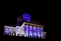 People stant in front of illuminated Helsinki St Nicholas cathed Stock Images