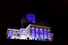People stant in front of illuminated Helsinki St Nicholas cathed Royalty Free Stock Photography
