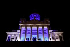 People stant in front of illuminated Helsinki St Nicholas cathed Royalty Free Stock Photos