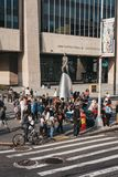 People by the statue of Adam Clayton Powell Jr. in Harlem, New York, USA stock photos