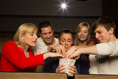 People stealing popcorn in cinema Royalty Free Stock Images