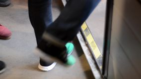 People Stepping Over A Threshold. Handheld Close-Up On Legs. stock footage