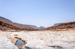 People on the stone river, Draa valley (Morocco) Stock Images