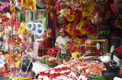 People stop to buy teddy and colorful toys on Hang Ma old street Royalty Free Stock Photos