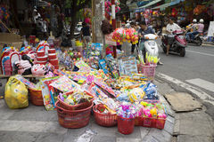 People stop to buy teddy and colorful toys on Hang Ma old street Stock Photo