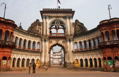 People stopped past historic indian gates with arches in ancient city Stock Photo
