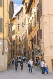 People on the street of the ancient Italian city Florence. Stock Photos
