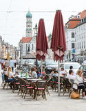 People at a street cafe in the city of Augsburg Stock Image